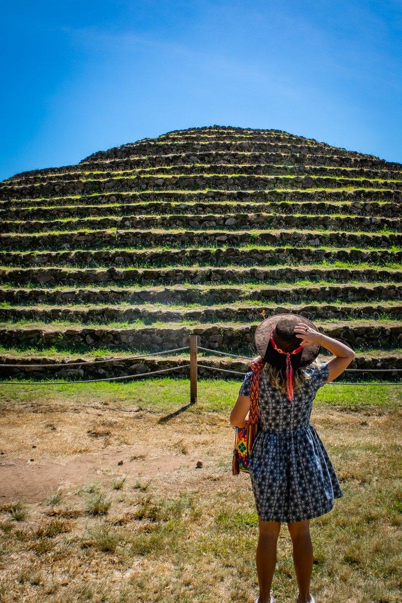 woman looking at Guachimontones in Guadalajara