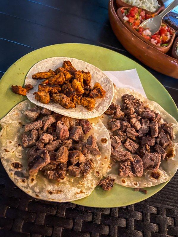 carne asada and pastor tacos