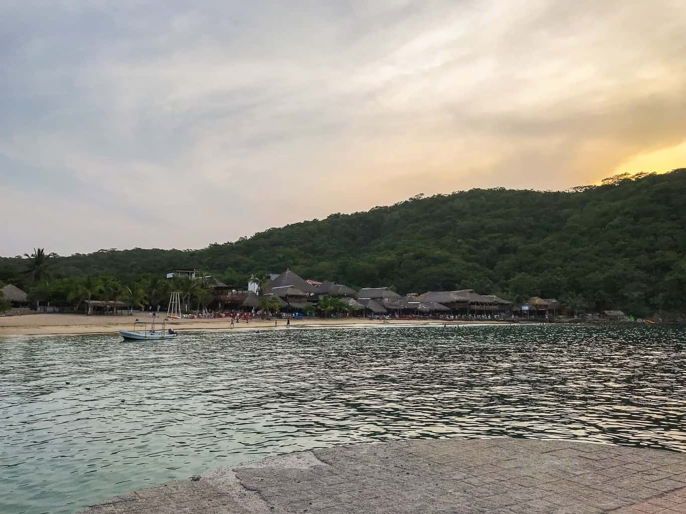 the sunset over playa arrocito in Huatulco