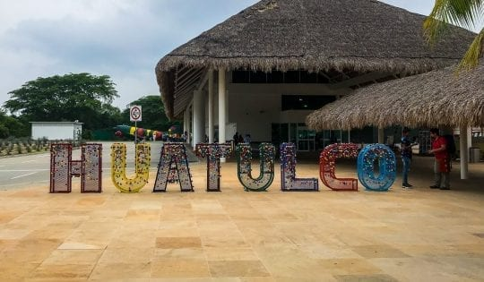 things to do in huatulco like check out the huatulco sign at the airport