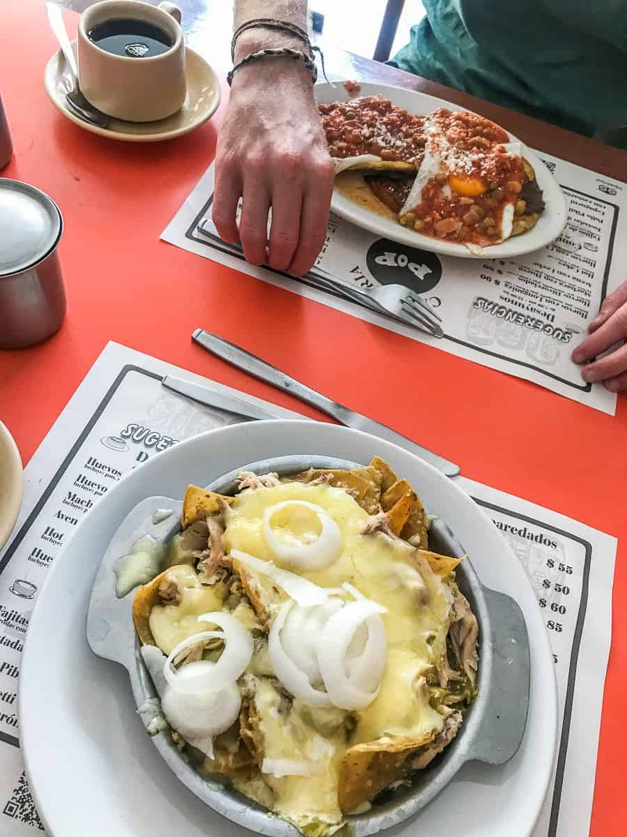 breakfast of huevos motulenos and chilaquiles at cafeteria pop