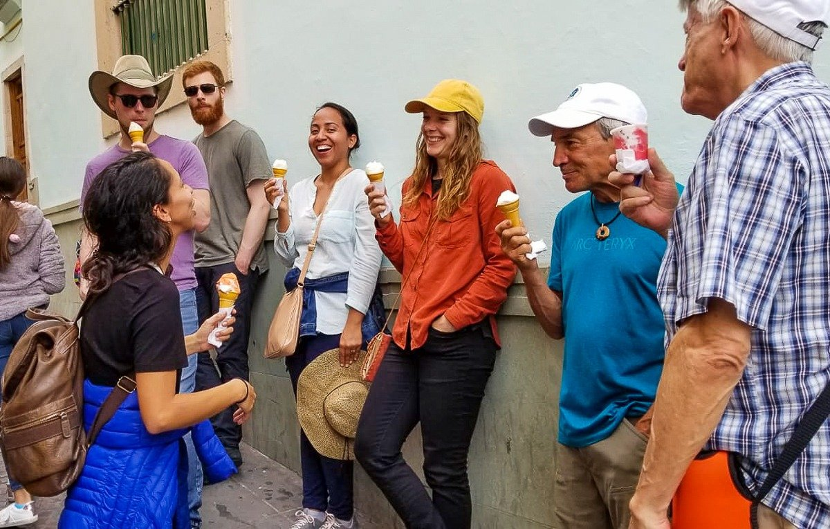 group tour with spanish and go eating ice cream