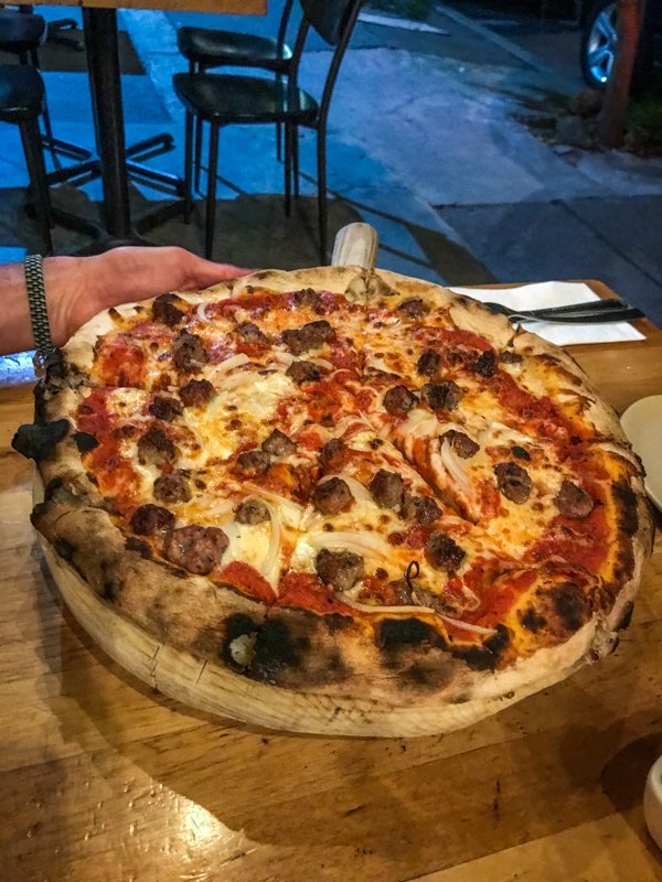 a pizza from Osteria 8 with sausage