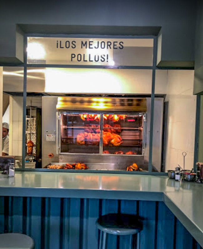 chickens on a rotisserie at the best restaurant in condesa