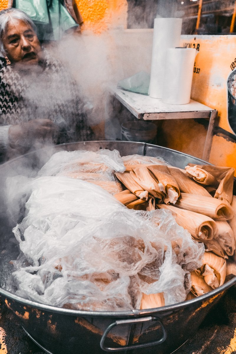 a pot full of tamales for breakfast in mexico city