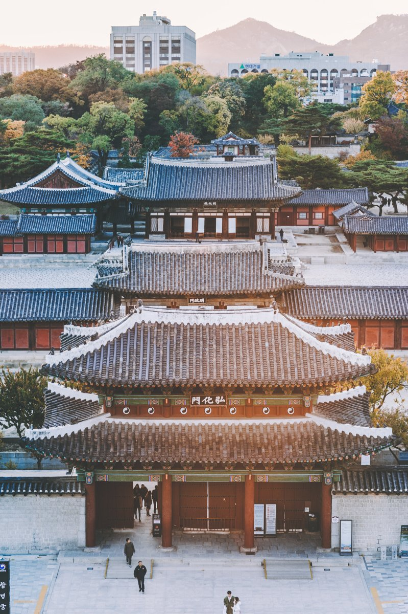 when wondering where to stay in seoul, look for unique hotels in traditional neighborhods like these old Korean buildings