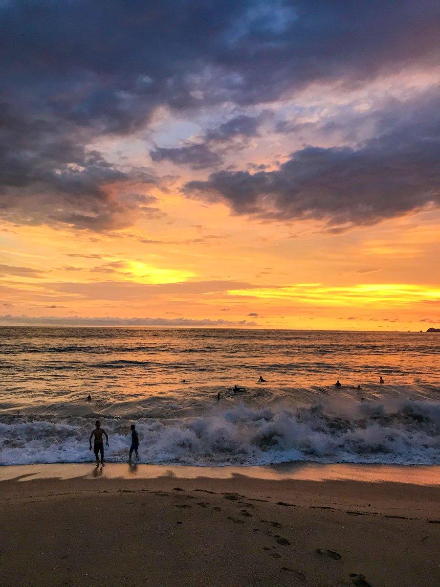 surfers in the ocean in barra de navidad jalisco
