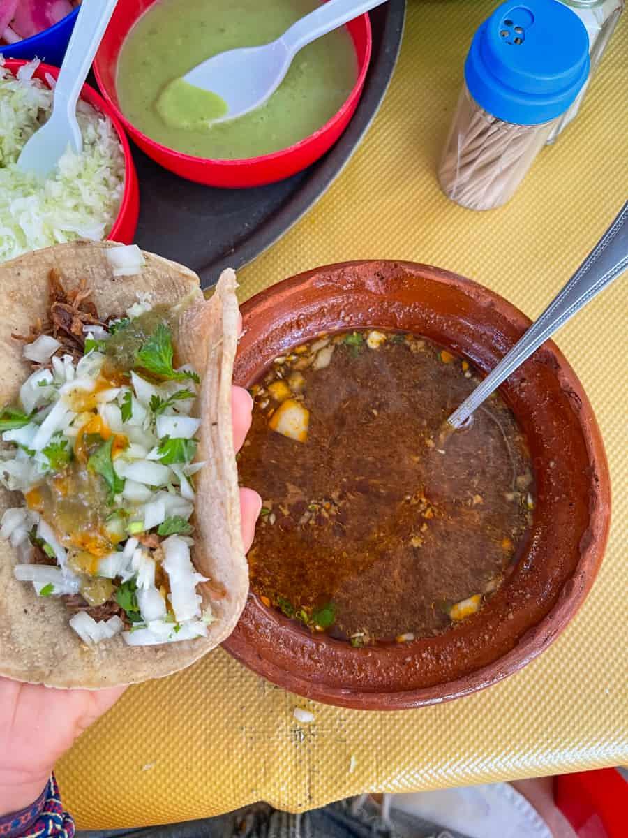 birria taco with consomme at el jalisciense birrieria in san jose del cabo