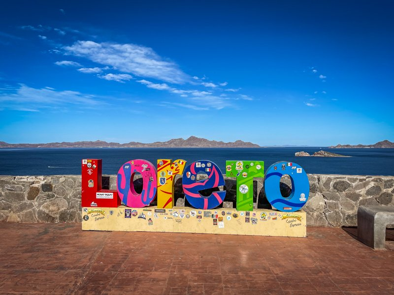 Sign that says Loreto in different colored letters