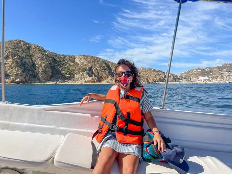 wearing a mask on a boat in Cabo san lucas