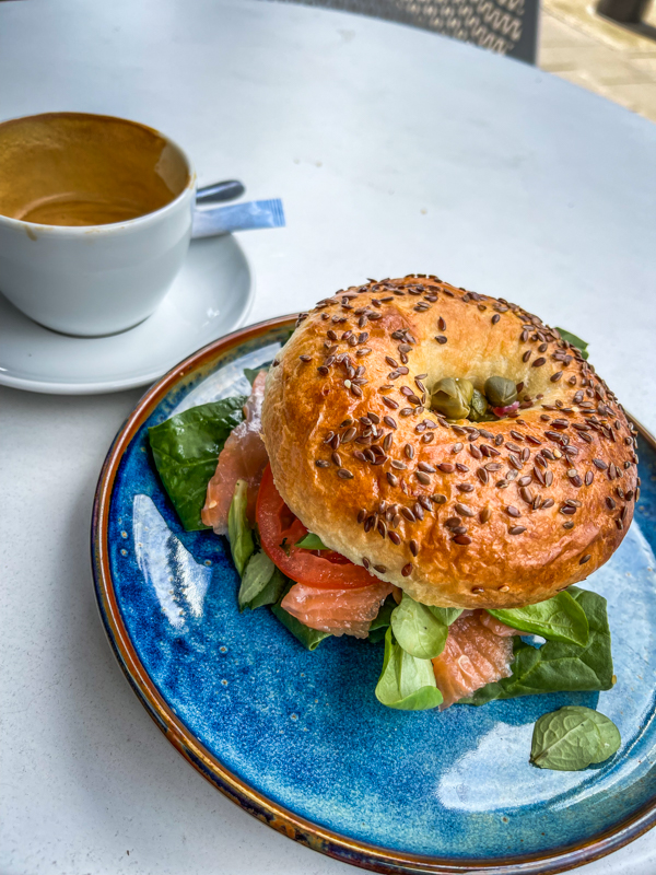bagel sandwich with coffee at restaurant in vilnius