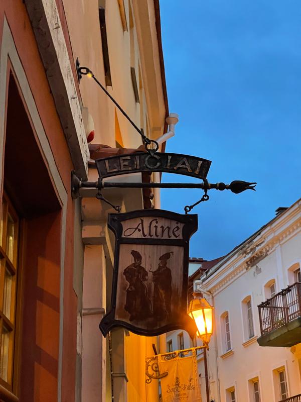 the aline (pub) sign outside of the bar in Vilnius
