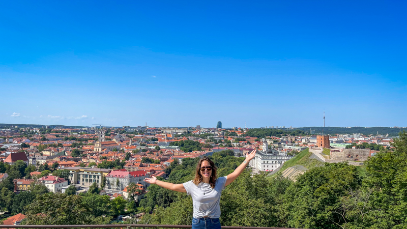 standing in front of the city of vilnius