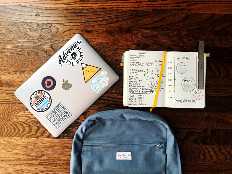studying with laptop and notebook near backpack