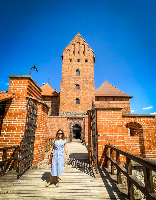 woman in front of trakai castle lithuania